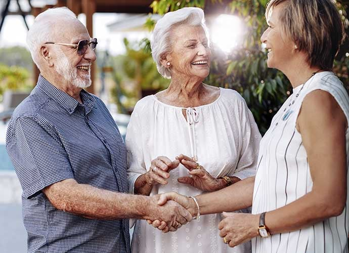 Couple shaking hands with Village Manager