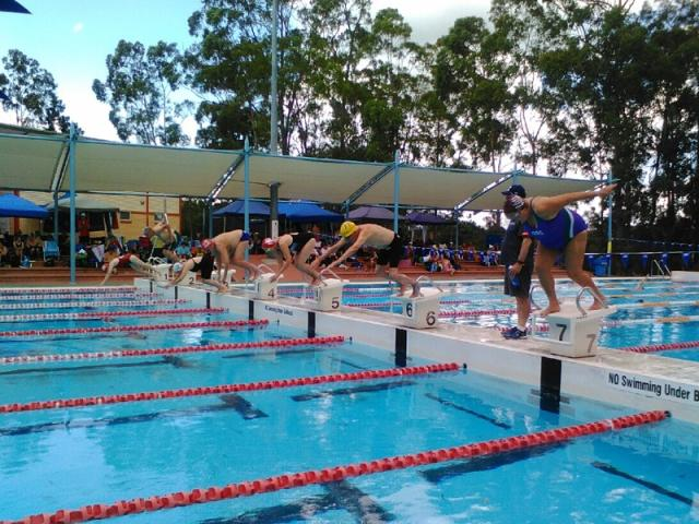 Resident beats two swimming world records