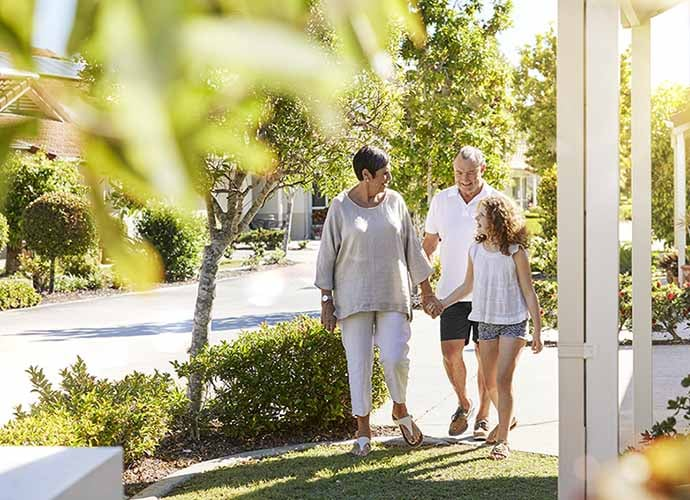 Residents walking through community with grandchild