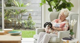 Durack Village Resident sitting with pet dog in home low res 800 x 450