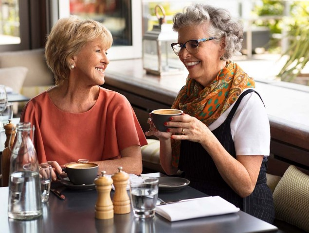 Aveo Corporate Lifestyle Two ladies drinking coffee at cafe Bella Vista external 1200x900