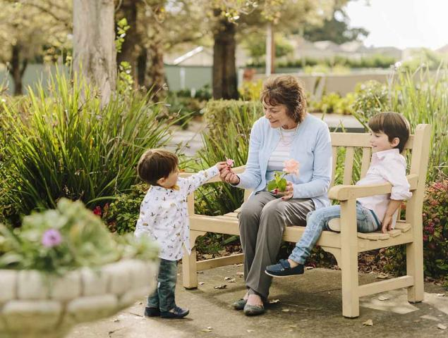 Aveo_Corporate_Lifestyle_Grandmother with flowers from grandchildren on bench_1200x900.jpg