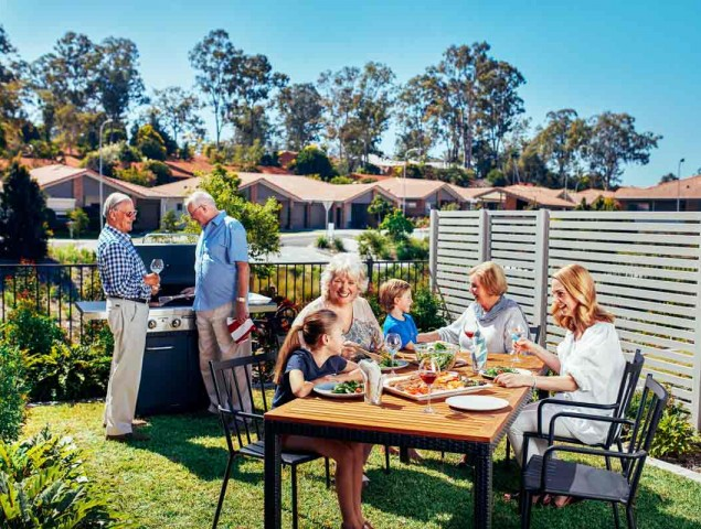 Durack Village Group of residents having bbq outside with family high res 110817