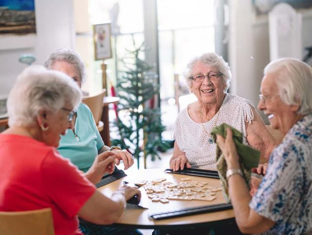 Residents playing game of scrabble
