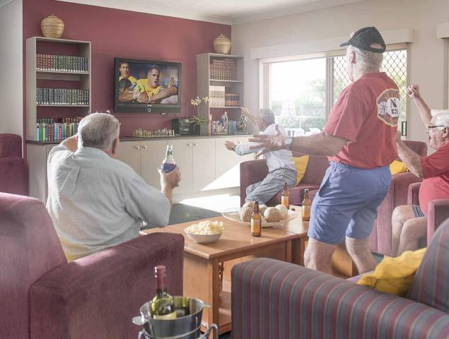 Group watching game on television