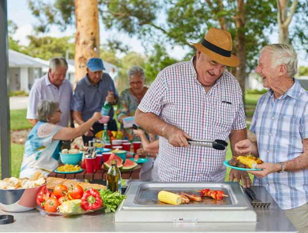 Resident having BBQ with family