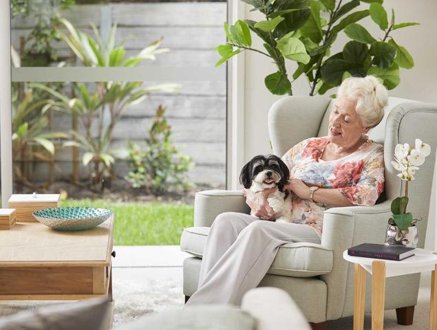 Resident sitting with dog