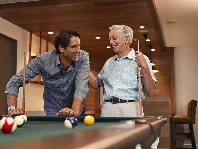 aveo retirement corporate care male resident and adult son playing pool billiards pools 1200x900
